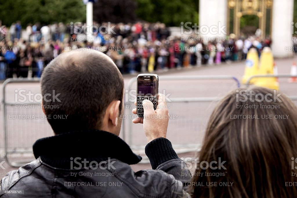 Man Taking a Picture with His Cell Phone royalty-free stock photo