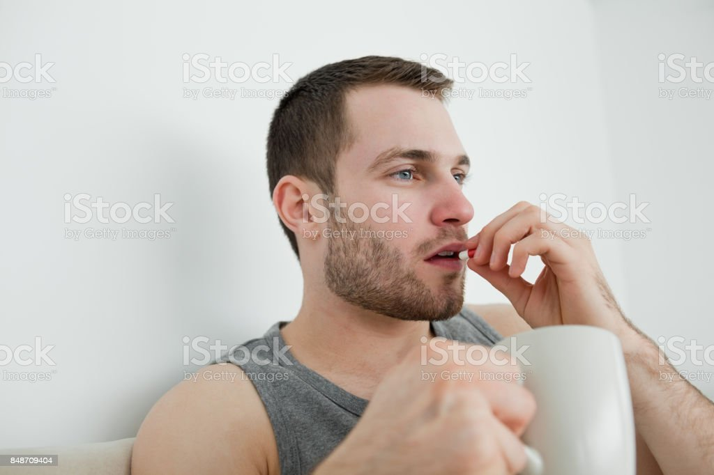 Man taking a pill stock photo
