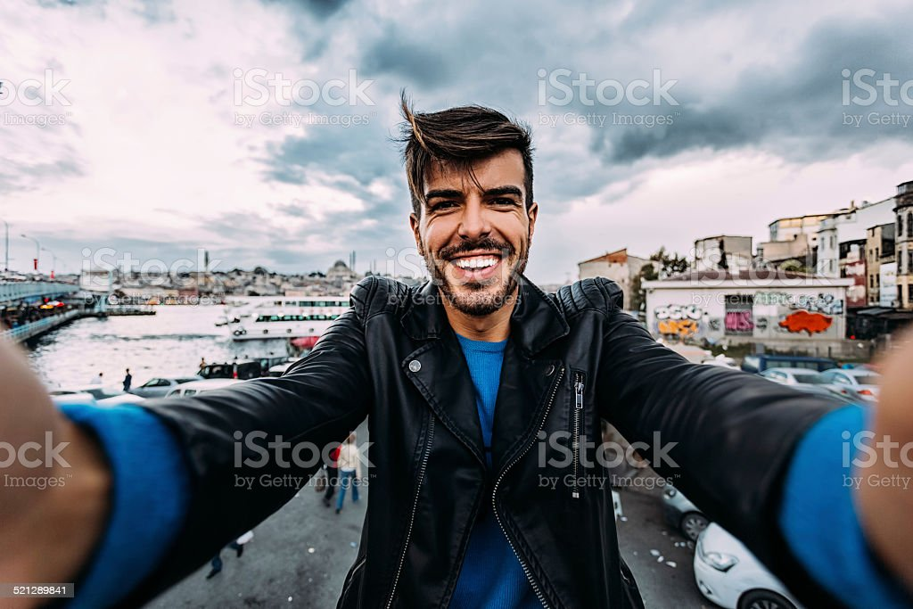 Man taking a selfie in Istanbul stock photo