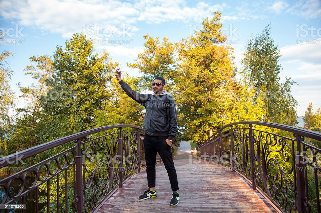 Man taking a selfie in nature and smiling stock photo