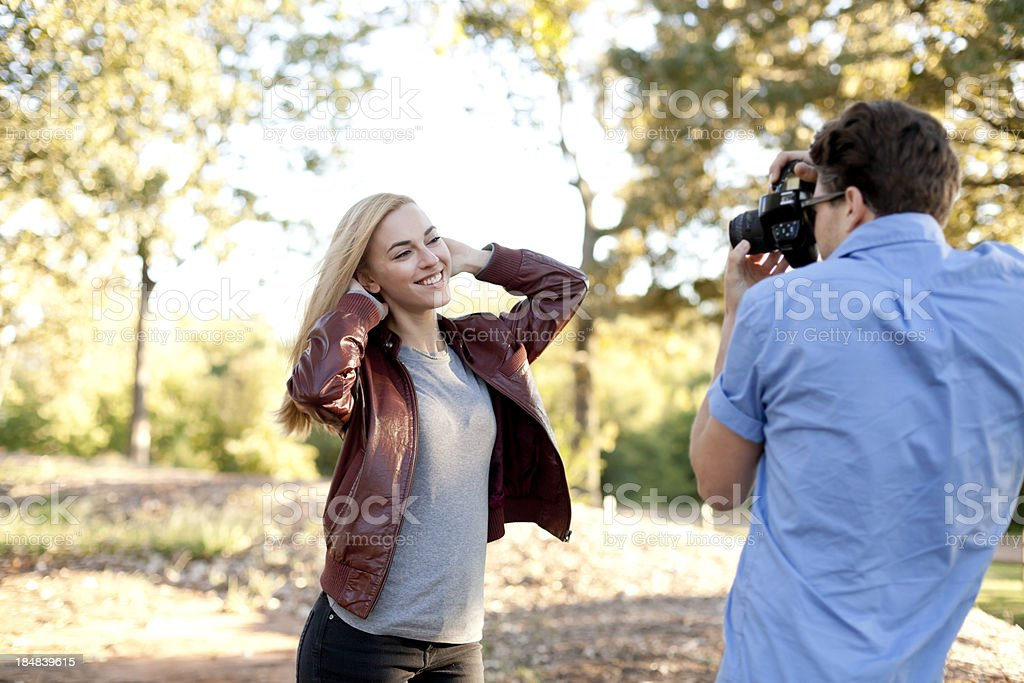Man Taking a Woman's Picture royalty-free stock photo