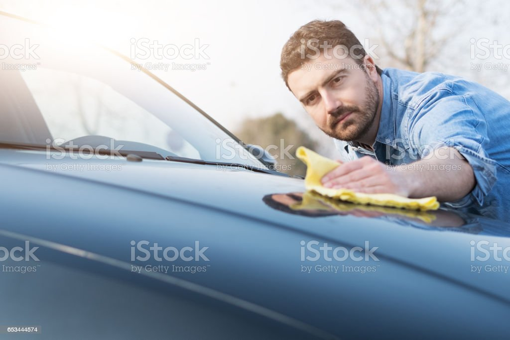 Man taking care and cleaning his car stock photo