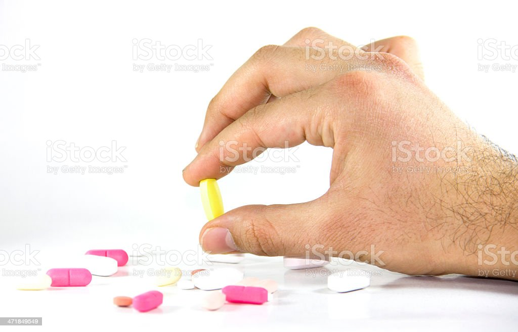 man Taking Daily Pills, Drugs, Supplements royalty-free stock photo