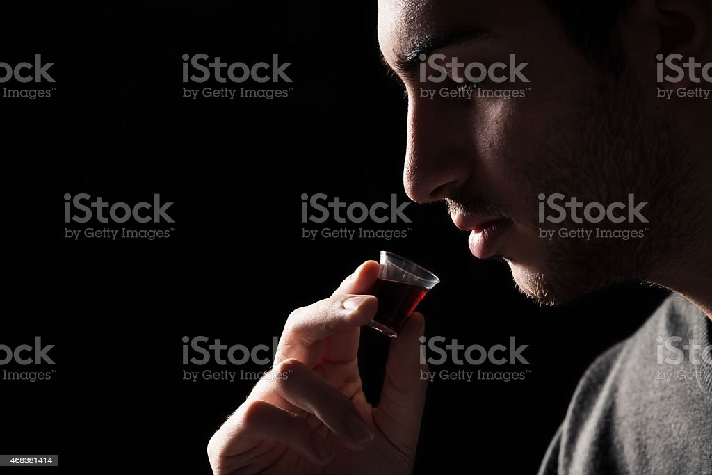 Man Taking Lords Supper stock photo