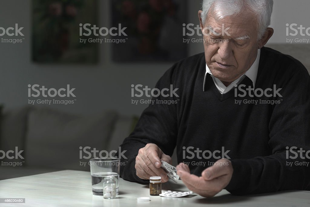 Man taking medicaments stock photo