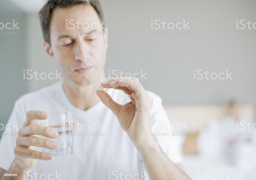 Man taking medicine stock photo
