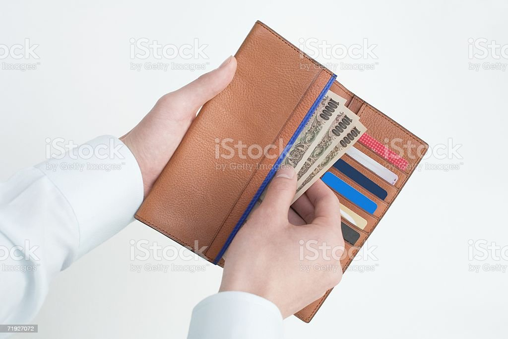 Man taking money from a wallet royalty-free stock photo