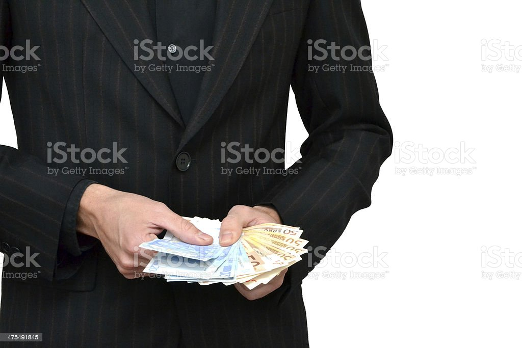 Man taking money out of the jacket stock photo
