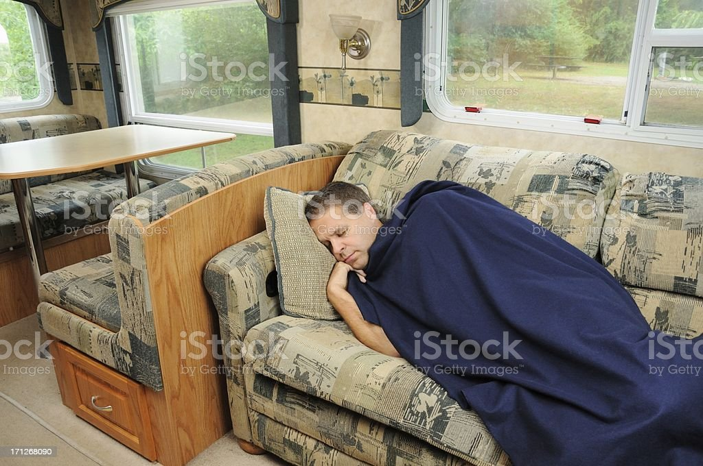 Man taking nap on rv couch royalty-free stock photo