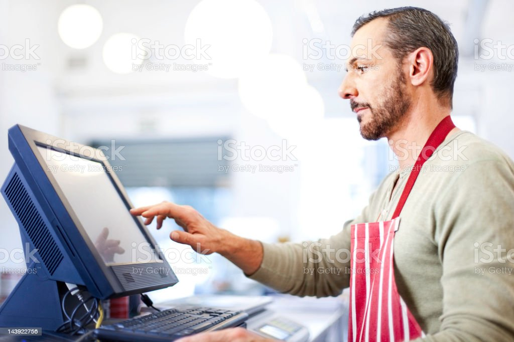 Man taking payment stock photo