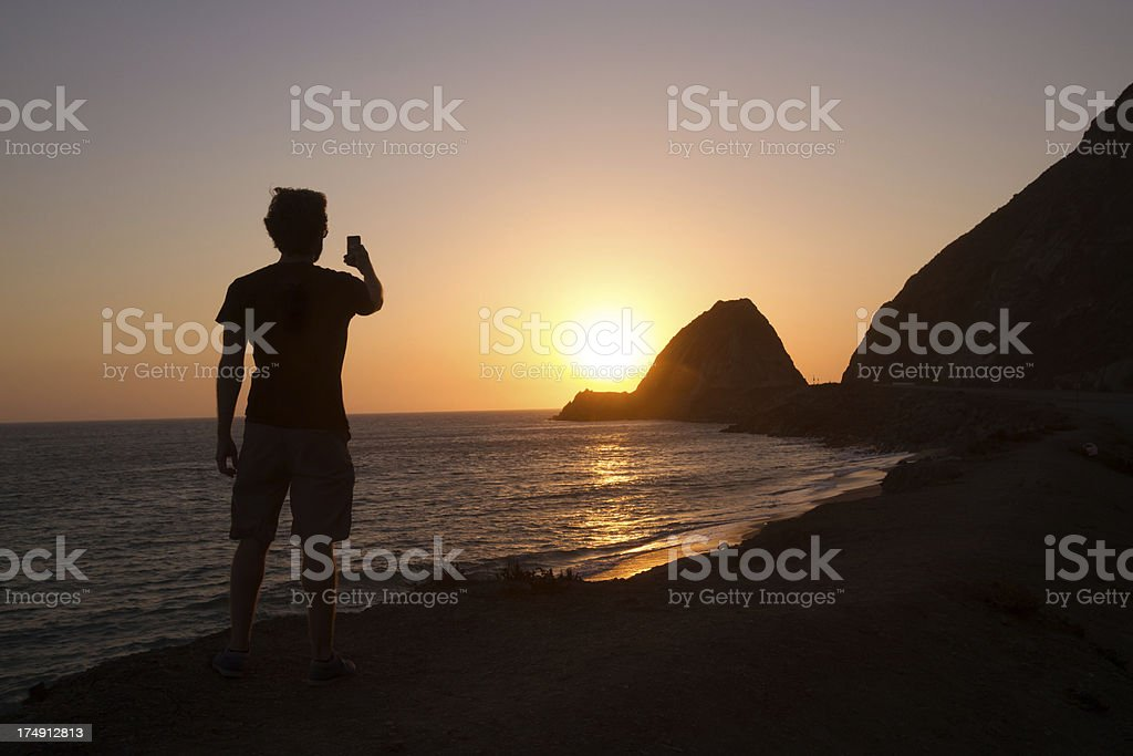Man taking photo with smart phone royalty-free stock photo
