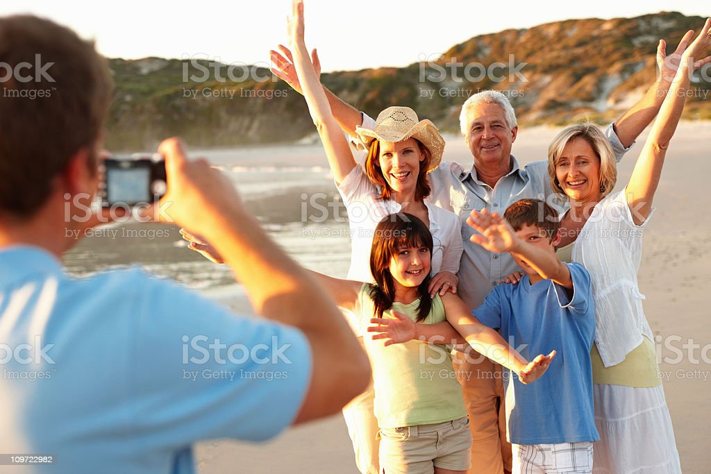 Man taking photograph in photography of his family royalty-free stock photo