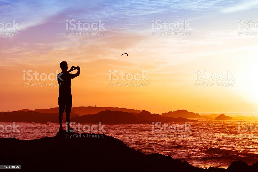 man taking photos with mobile smart phone stock photo
