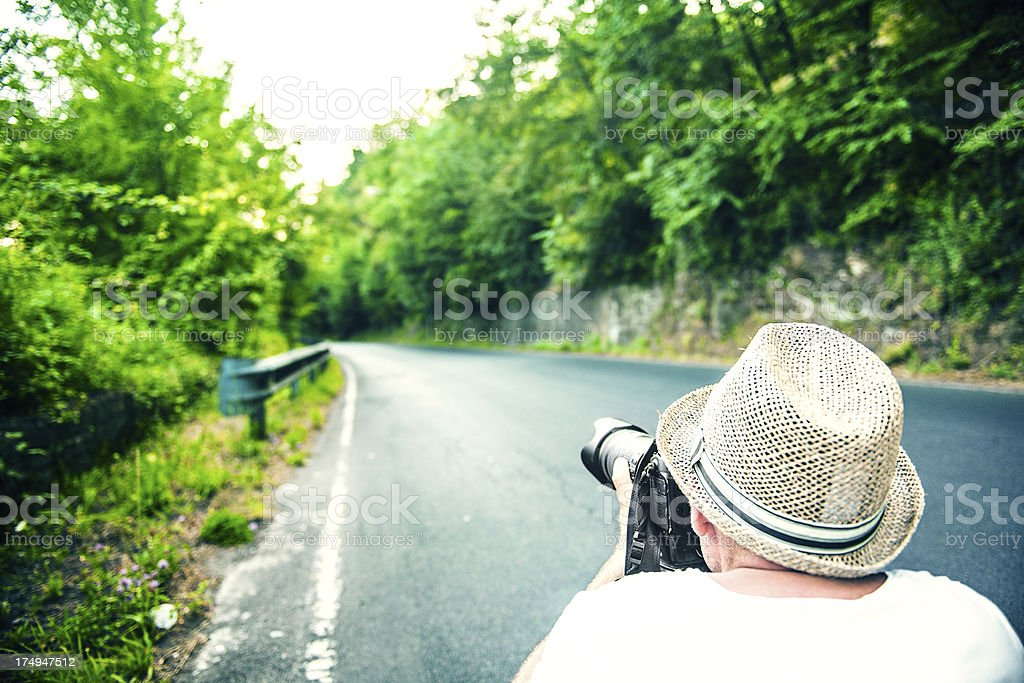 Man taking picture of a road royalty-free stock photo