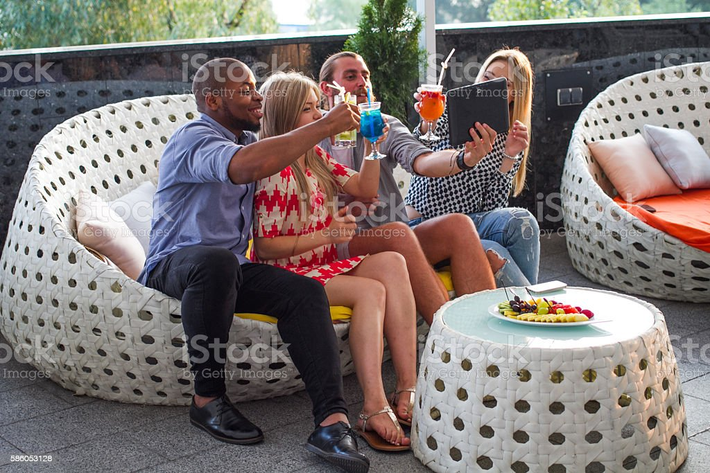 Man taking picture of himself with friends stock photo