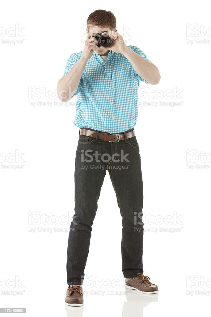 Man taking picture with camera royalty-free stock photo