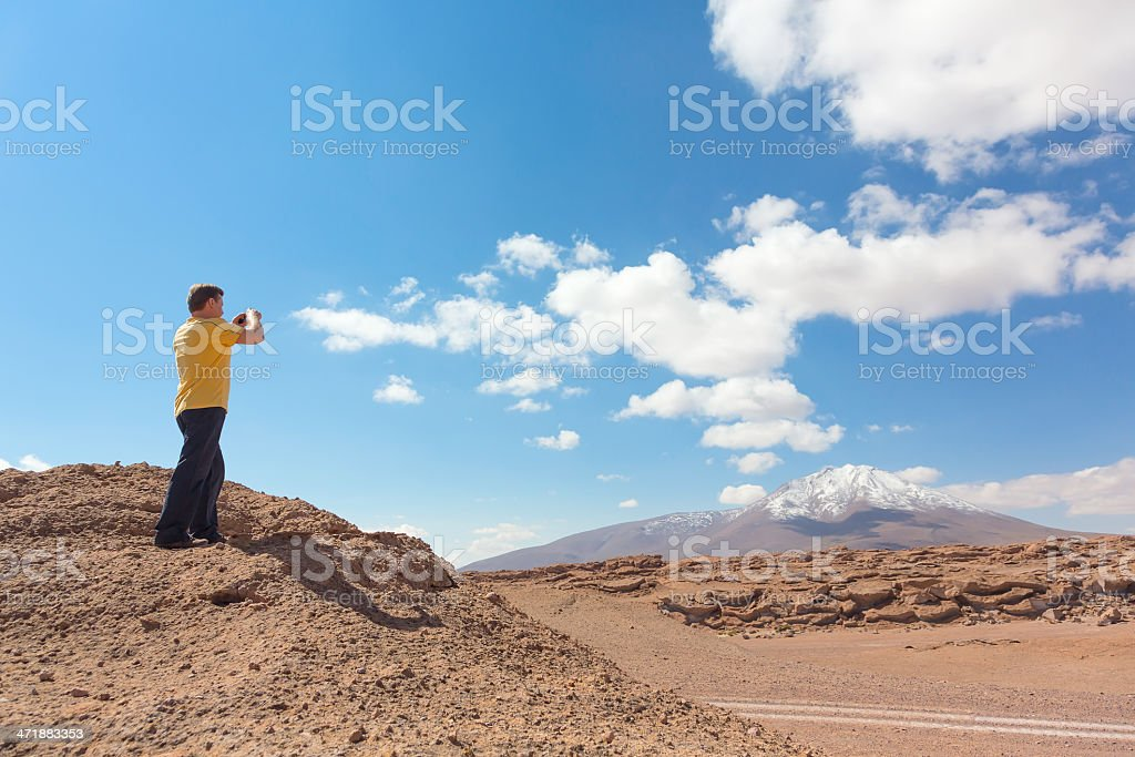 Man taking pictures on camera royalty-free stock photo