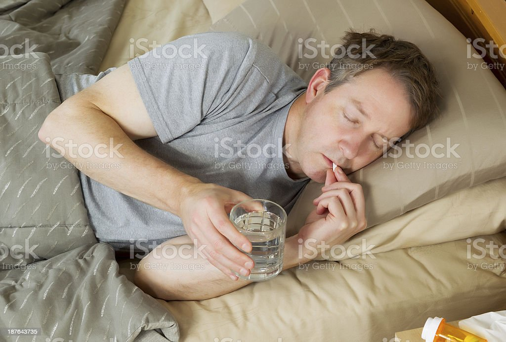 Man taking Pill for cold stock photo