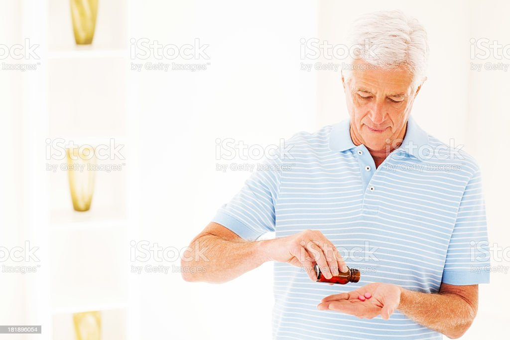 Man Taking Pills From Prescription Bottle royalty-free stock photo