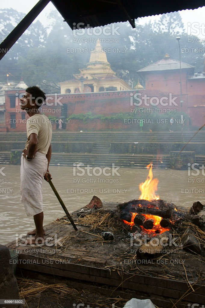 man taking rest cremation process in Ram Ghat, Pashupatinath stock photo