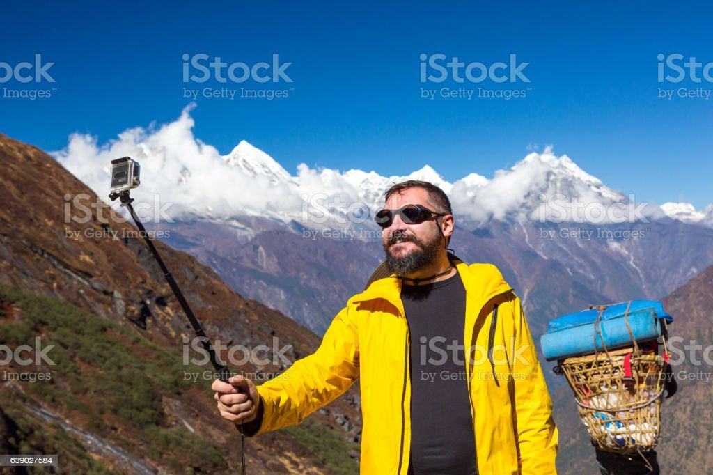 Man taking self portrait during mountain trekking stock photo
