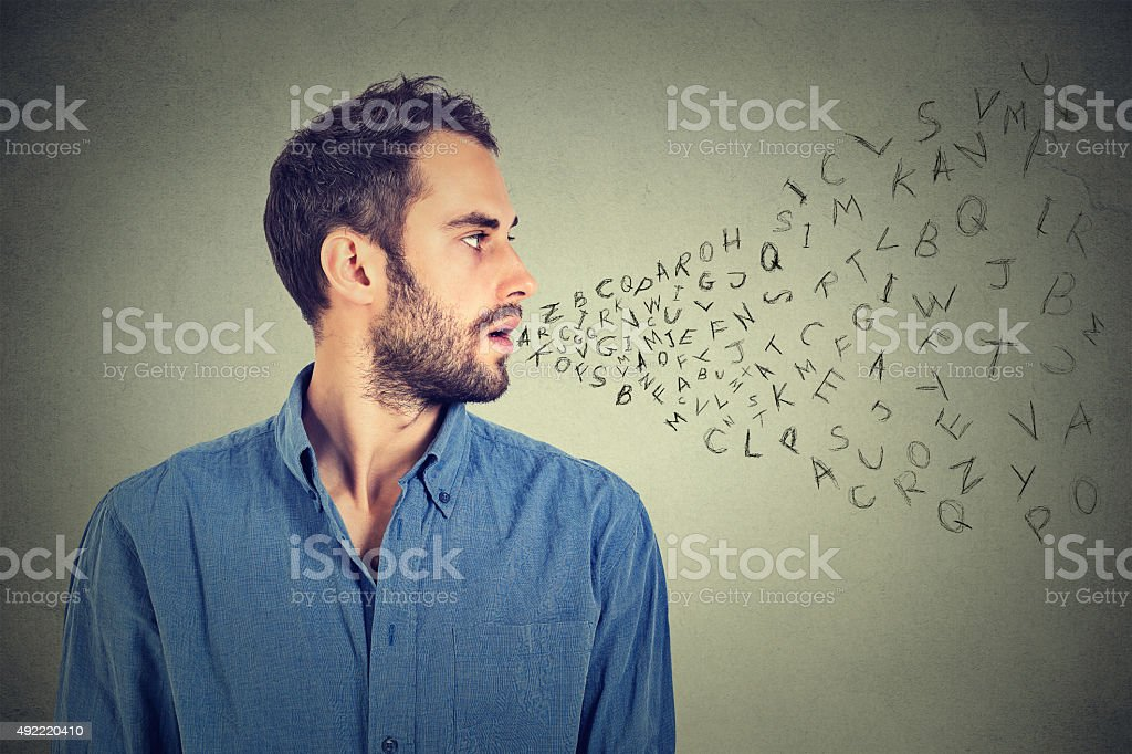 Man talking alphabet letters coming out of his mouth stock photo