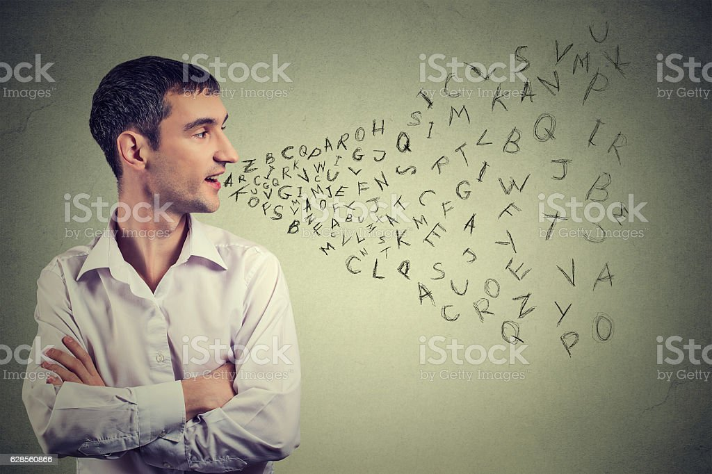 Man talking alphabet letters coming out of mouth stock photo