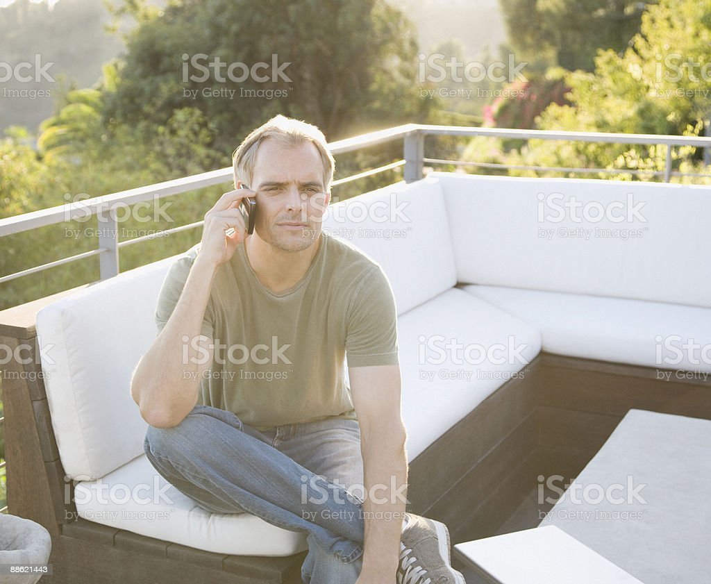 Man talking on cell phone on deck royalty-free stock photo