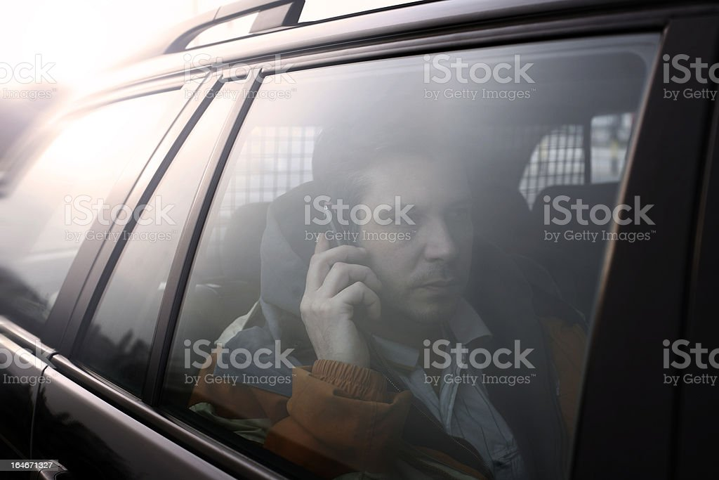 Man talking on the telephone in car - blue tone royalty-free stock photo