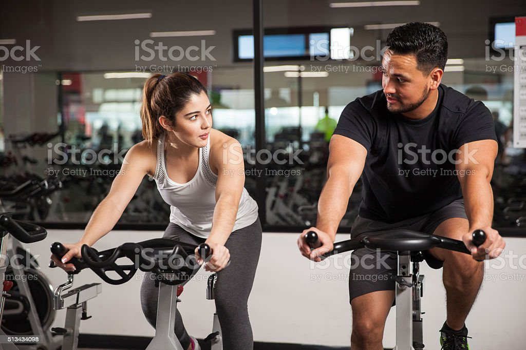 Man talking to a woman at the gym stock photo