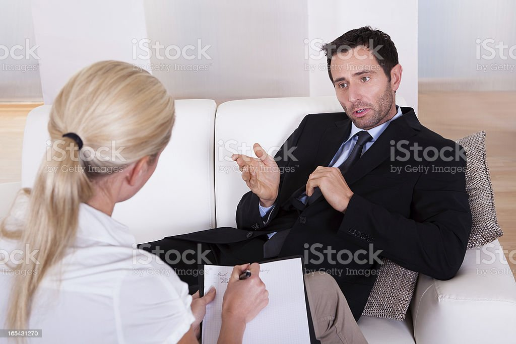 Man talking to his psychiatrist royalty-free stock photo