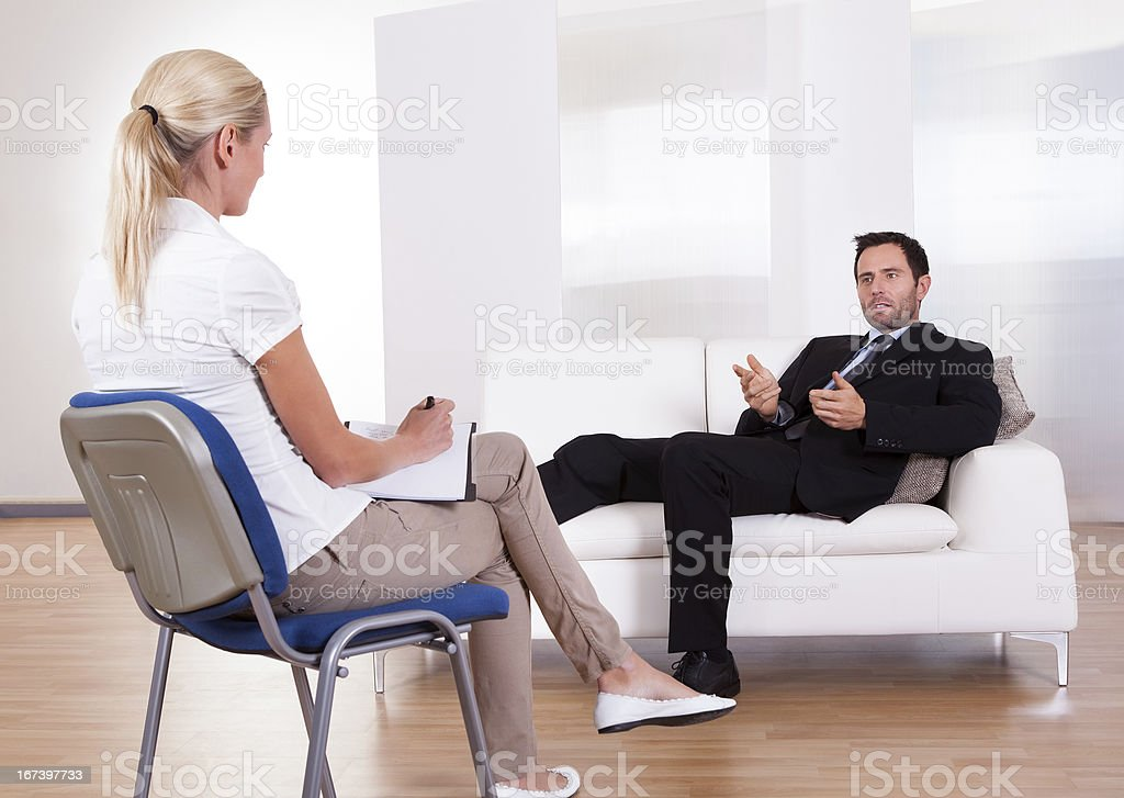 Man talking to his psychiatrist royalty-free stock photo