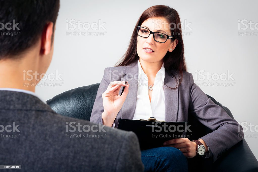 man talking to his psychologist stock photo