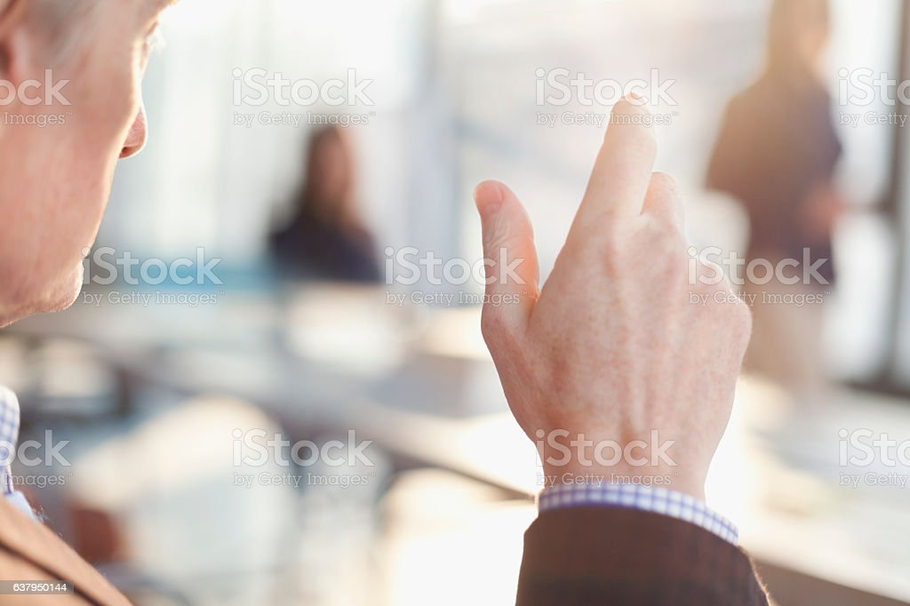 Man talking with hand gesture in business team meeting stock photo