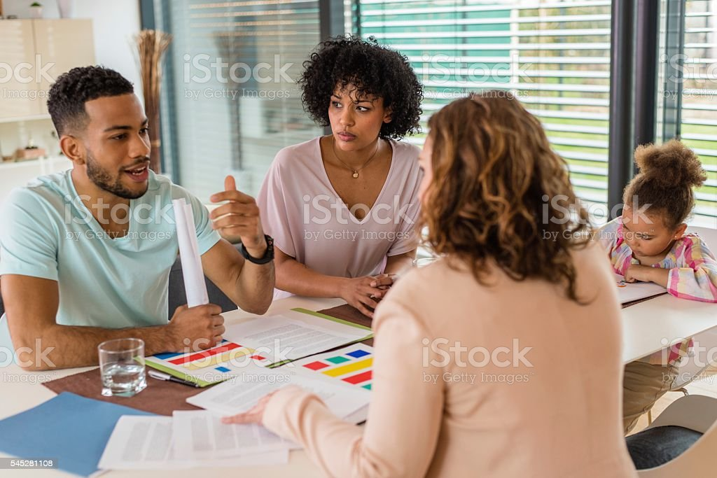 Man talking with interior designer stock photo