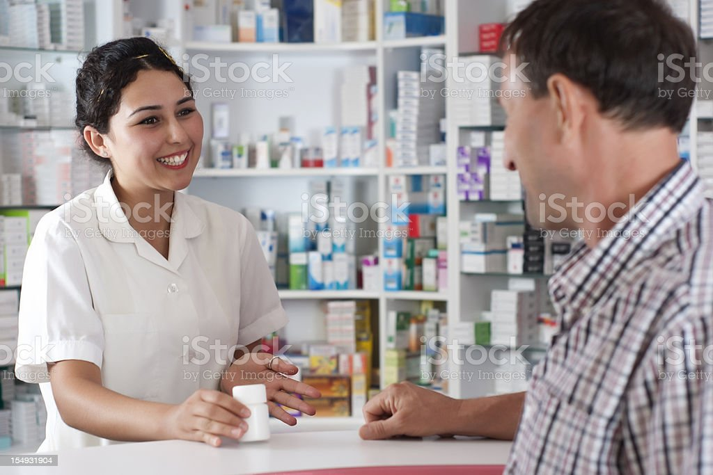 man talking with pharmacist royalty-free stock photo