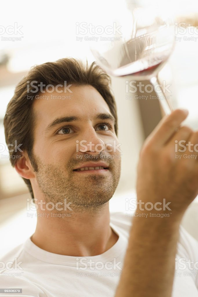 Man tasting a glass of red wine royalty-free stock photo