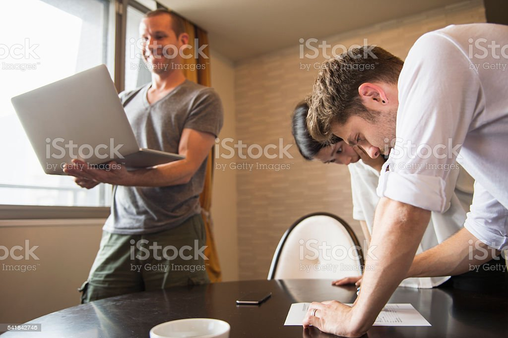 Man taught how to write documents to woman stock photo