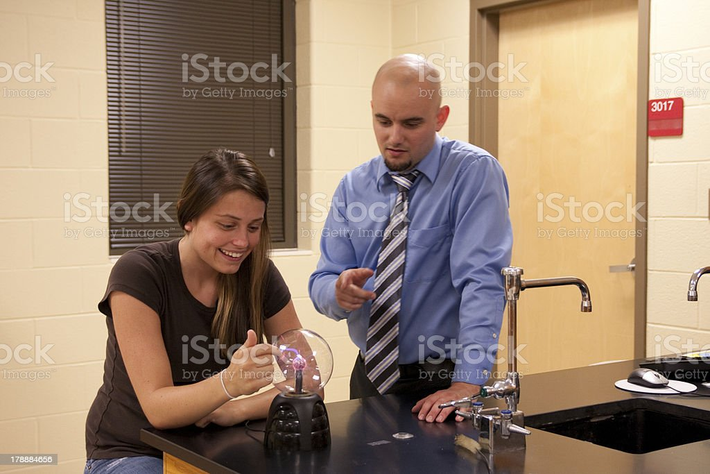 Man teaching science to a female student. royalty-free stock photo