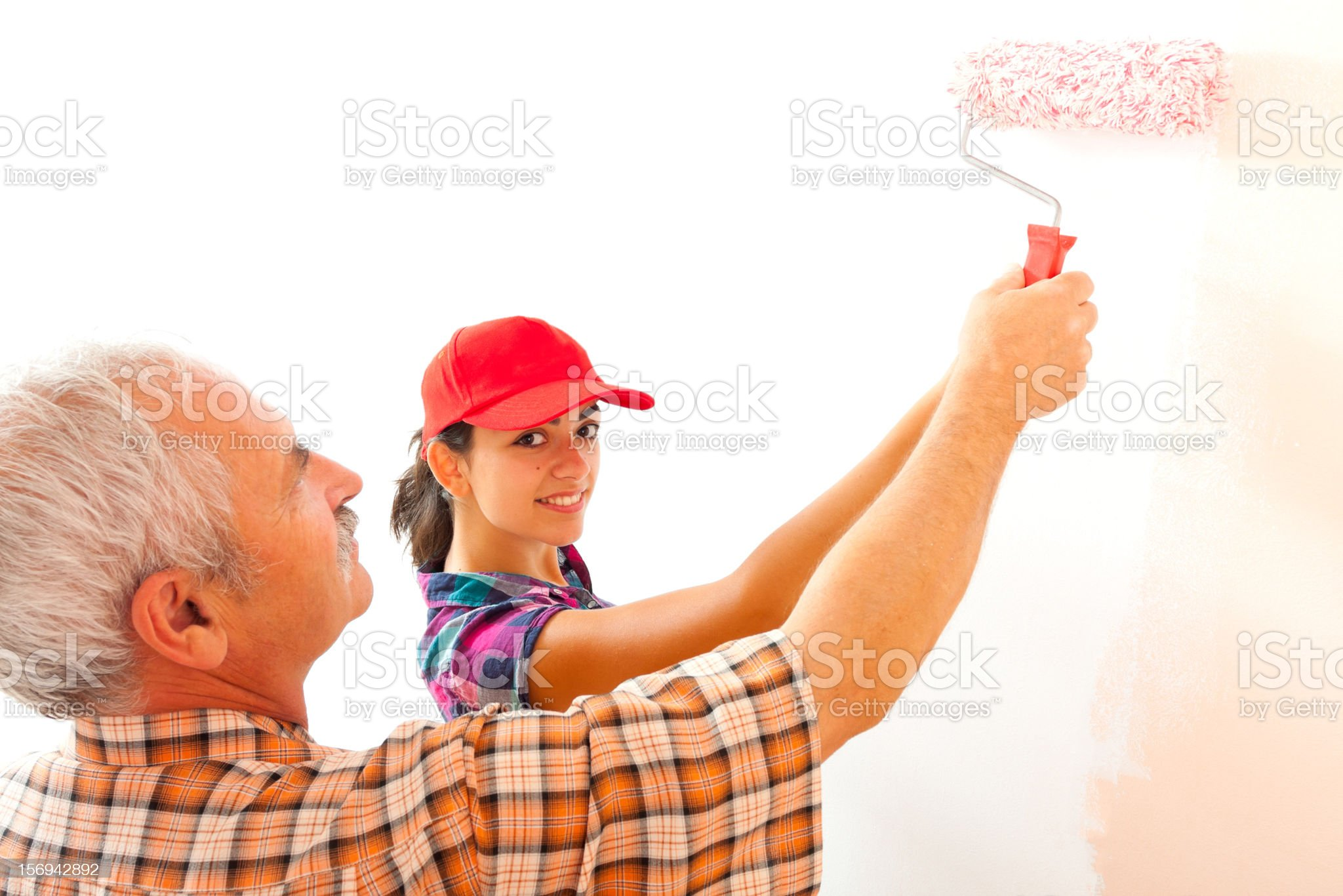 Man teaching young how to redecorate royalty-free stock photo