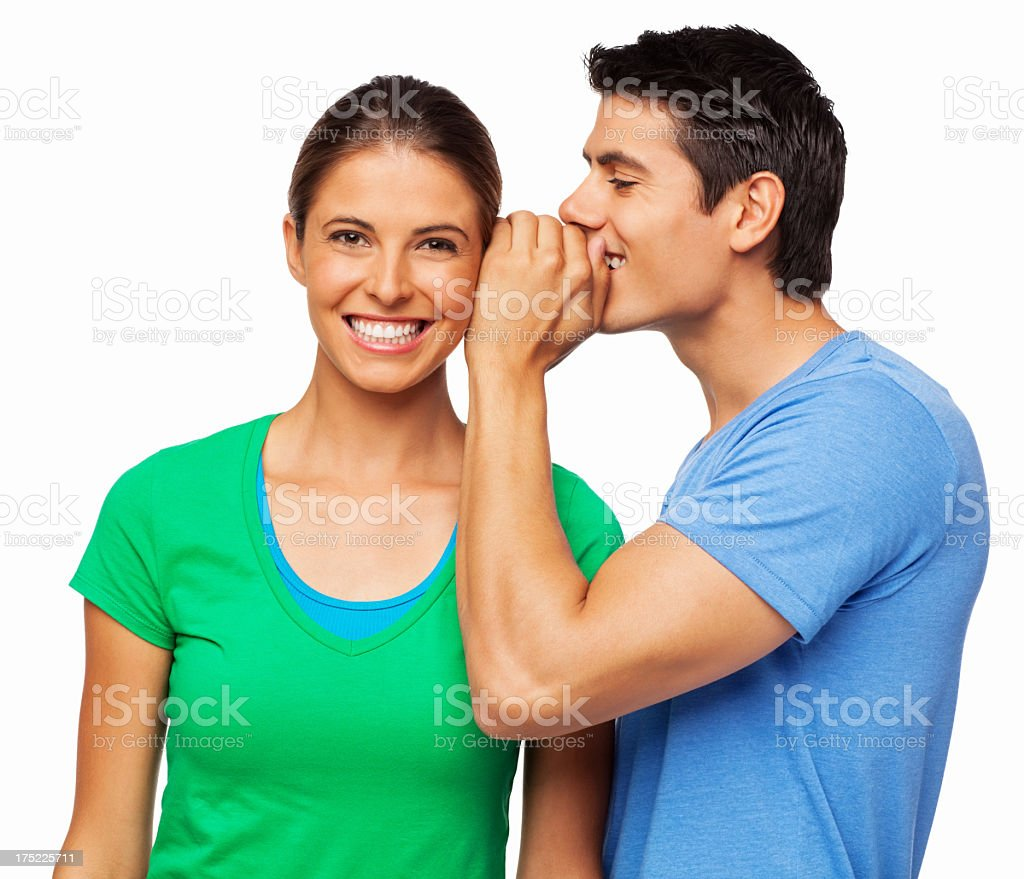 Man Telling a Secret To His Girlfriend - Isolated royalty-free stock photo