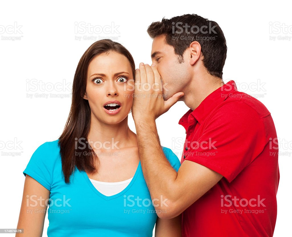 Man Telling a Secret To Woman - Isolated royalty-free stock photo