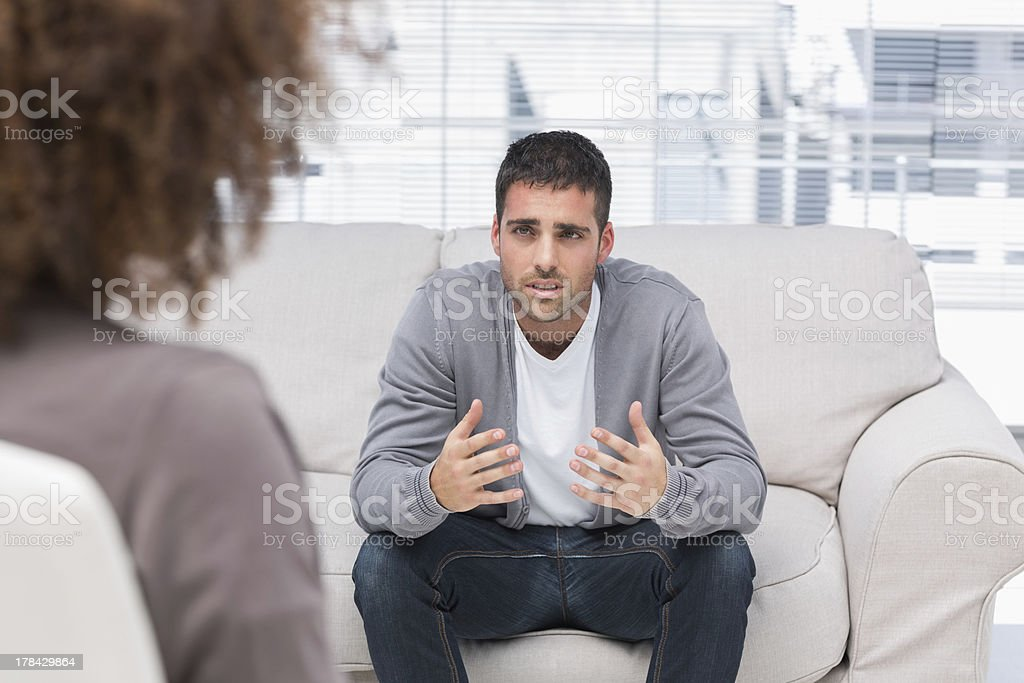Man telling therapist his problems stock photo