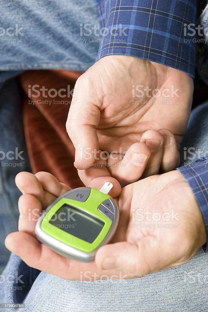 Man Testing His Blood Sugar With Glucometer royalty-free stock photo