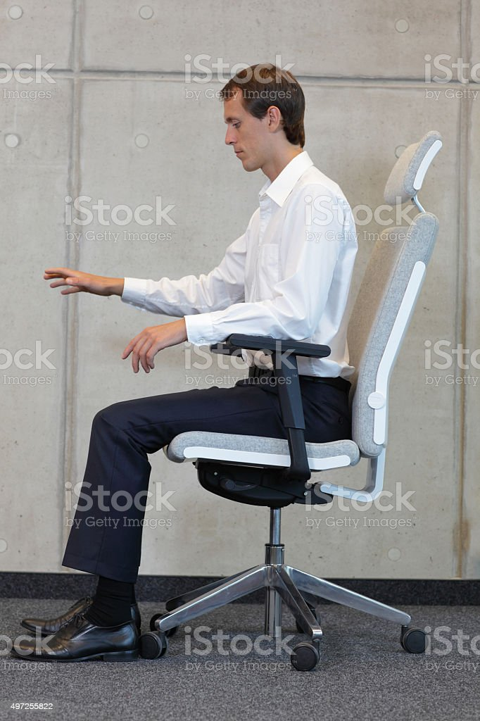 Man testing office chair stock photo