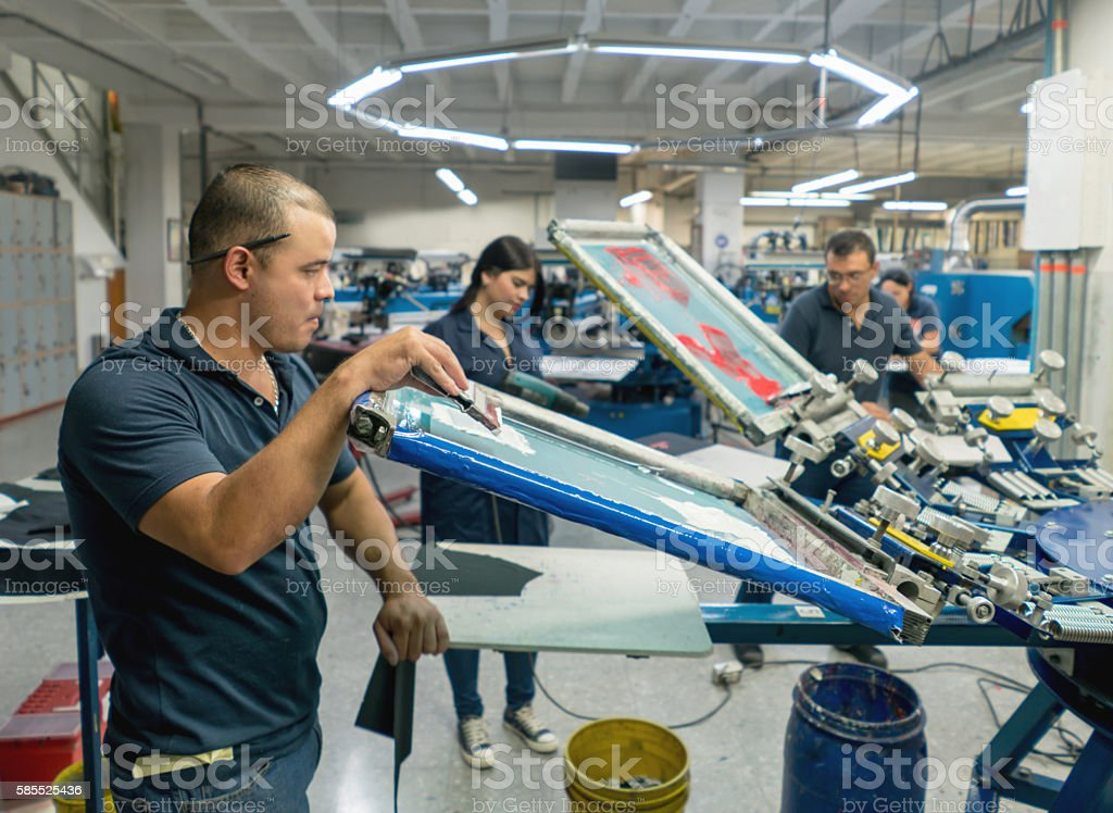Man textile printing at a factory stock photo