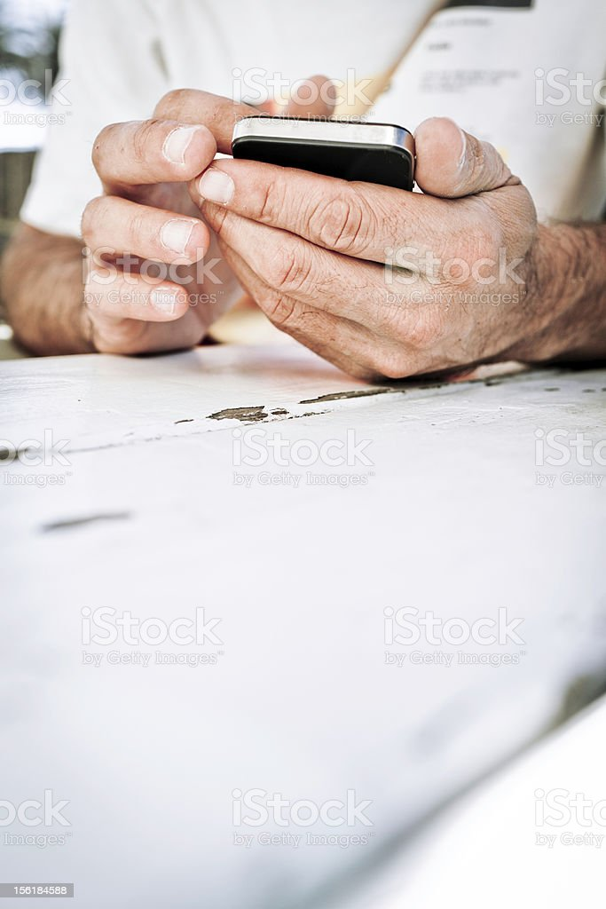 Man texting on cell phone royalty-free stock photo