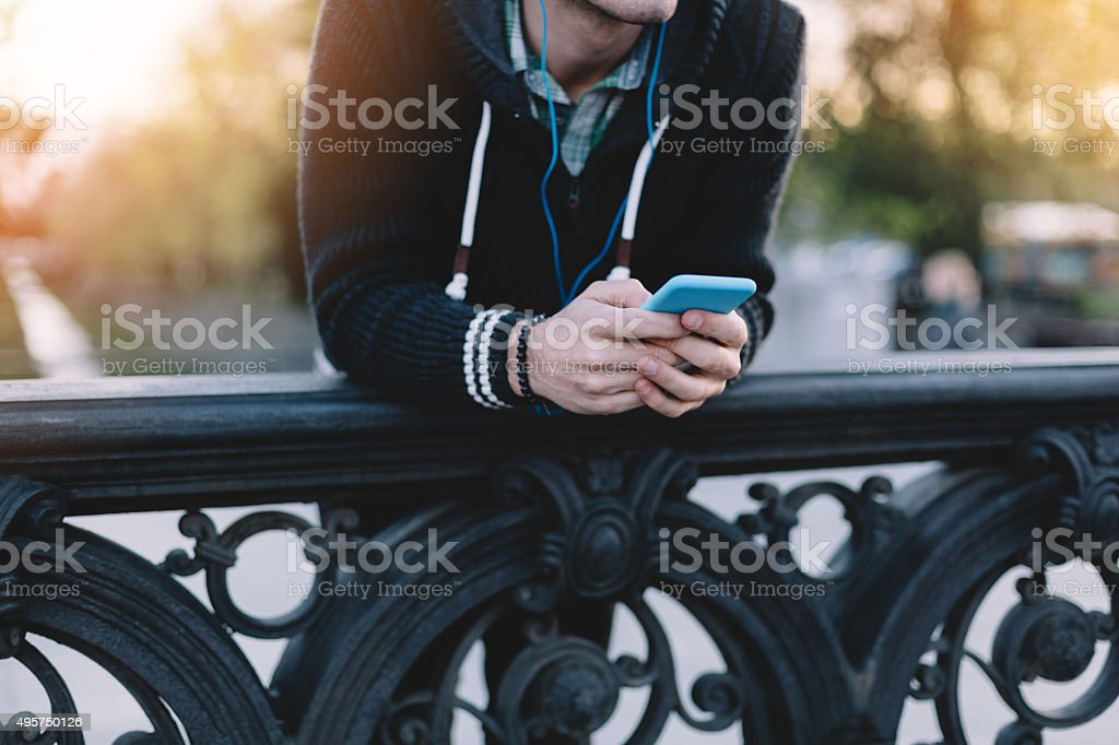 Man texting on smartphone stock photo