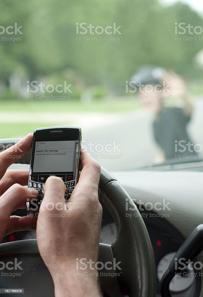 Man texting while driving about to hit boy on scooter royalty-free stock photo