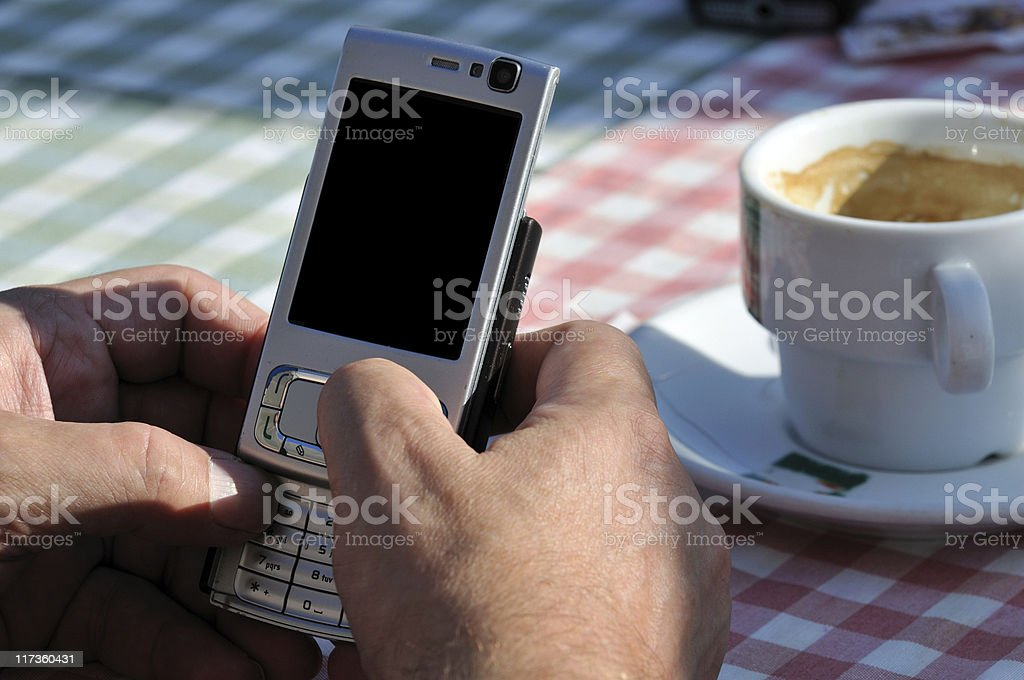 Man texts on a phone without touch screen royalty-free stock photo